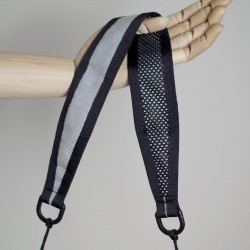 The large strap features mesh on the back